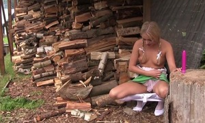 Pretty blonde ecumenical in cute dress plays all over her coochie outdoors