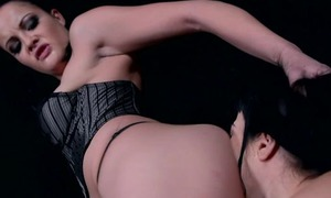 Hot dust-ball in black stockings fucks her slave girl with favorite toy